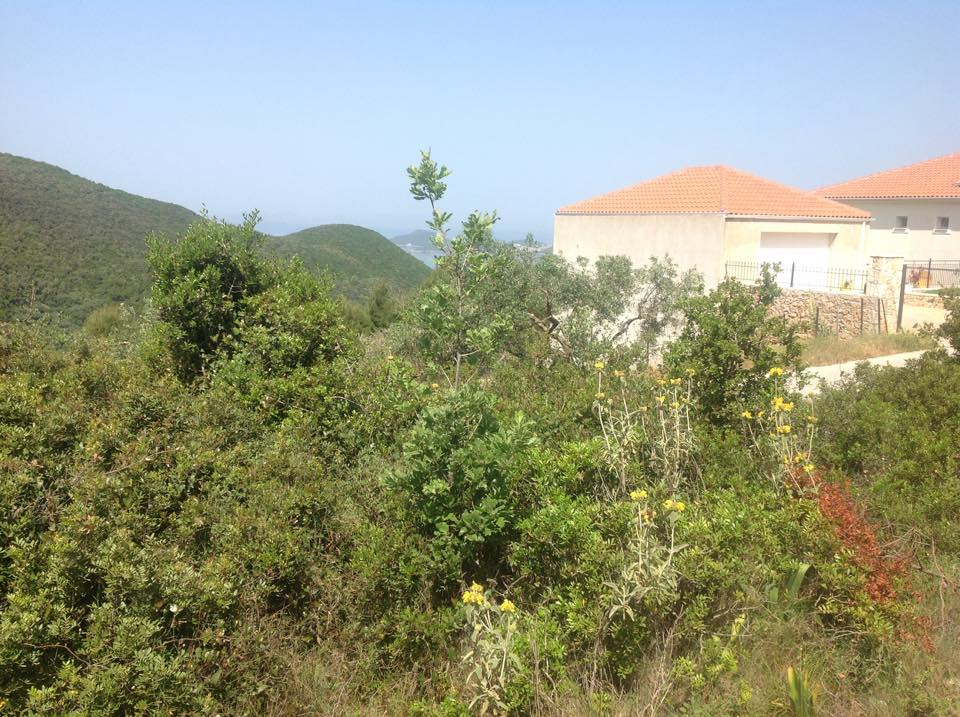 Plot of 1.263m² with a view of Perdika for sale. Price 120,000 EUR.(011)